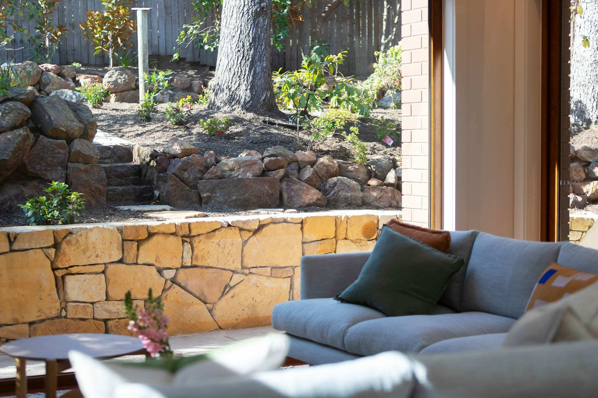 Homes by Howe Canberra builder – Governor Generals' renovation extension – Family room with stone retaining wall
