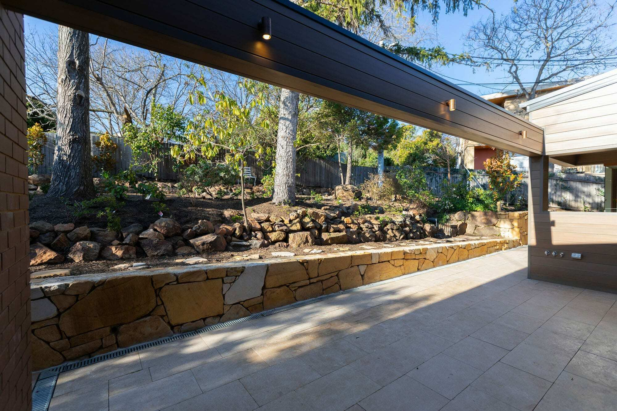 Homes by Howe Canberra builder – Governor Generals' renovation extension – Landscaping with stonework